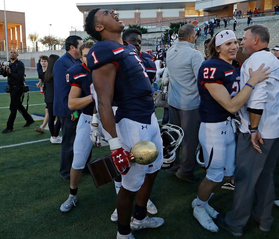 Denton Ryan High School Ja'tavion Sanders (1) lets out a scream while holding the semifinalist championship trophy after winning 35-7 as Frisco Lone Star High School played Denton Ryan High School in a Class 5A Division I state semifinal game at Eagle Stadium in Allen on Saturday, December 14, 2019. (Stewart F. House/Special Contributor)