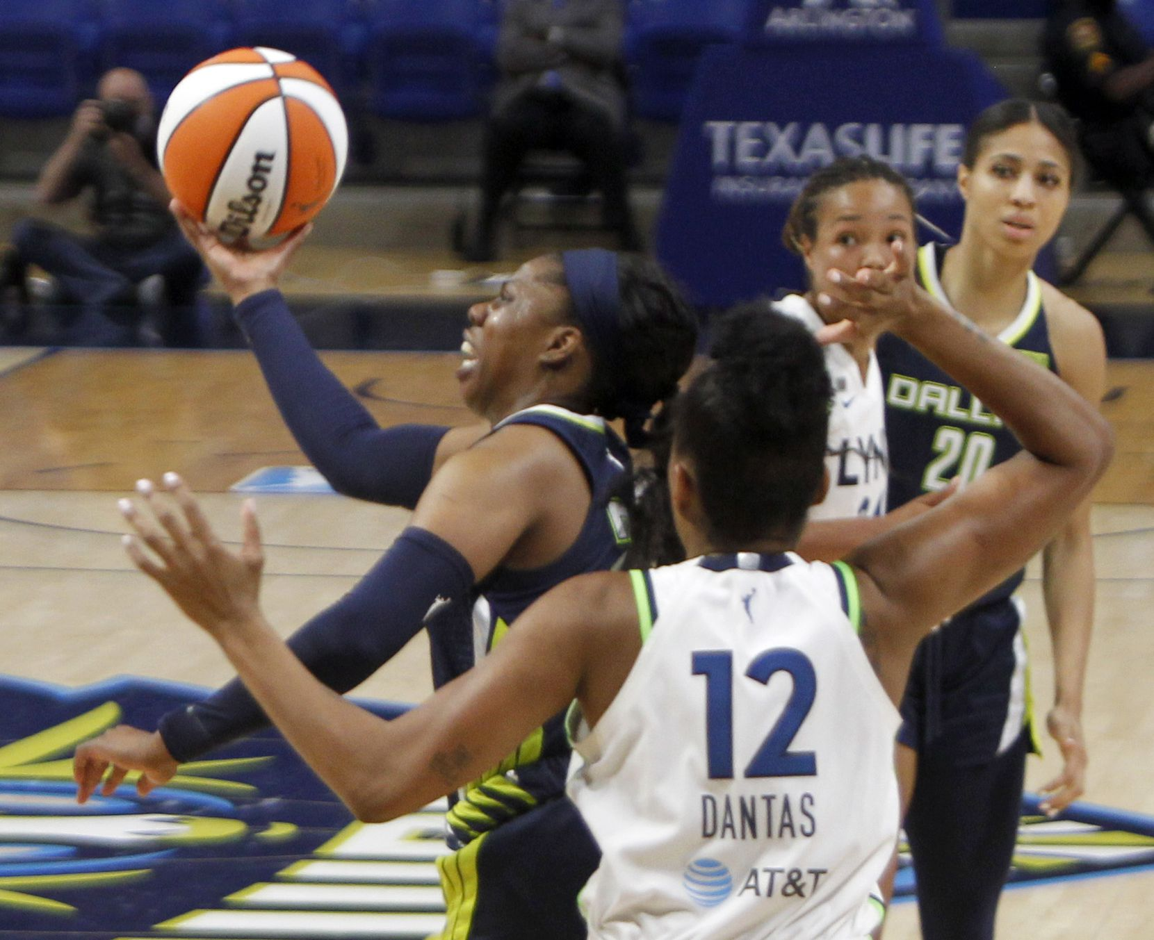 Dallas Wings guard Arike Ogunbowale (24) drives the lane after cutting inside the defense of Minnesota Lynx forward Damiris Dantas (12) during the 3rd quarter of play. The two teams played their WNBA game at College Park Center on the campus of the University of Arlington on June 17, 2021(Steve Hamm/ Special Contributor)