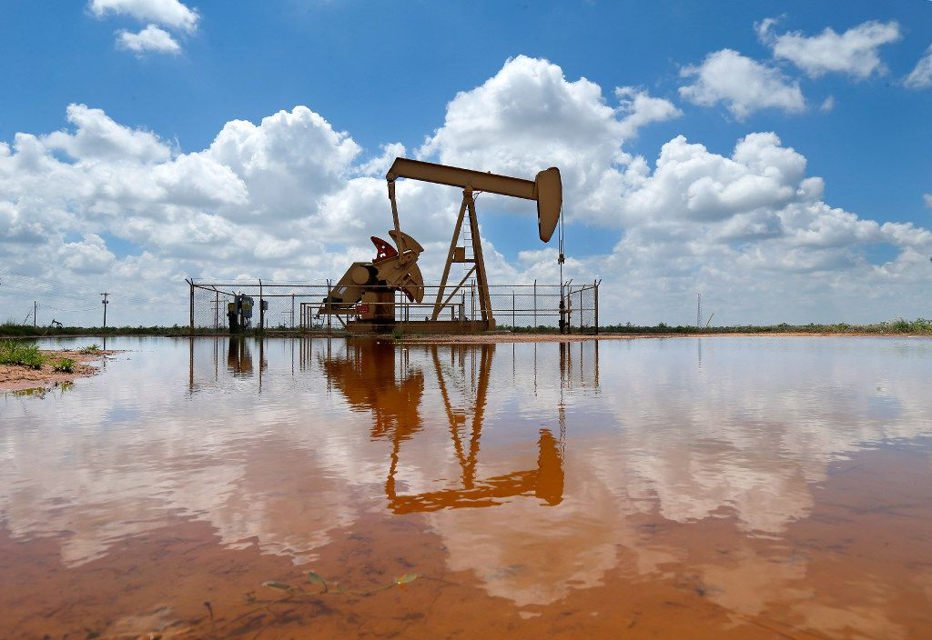 A pump jack draws oil north of Lubbock, Texas, Wednesday, August 2, 2017.
