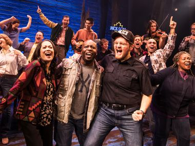 """""""Come From Away"""" tells the story of 6,500 passengers whose planes were diverted to the small Canadian town of Gander, Newfoundland on 9/11, and the local people who took care of them for five anxious days. The North American tour of the hit Broadway musical stops in Dallas at the Music Hall at Fair Park from March 10-22. Dallas actor Chamblee Ferguson (wearing a letter jacket and pointing to the sky in background) is one of the show's 12 lead singers."""