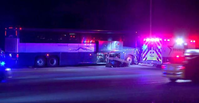 A Greyhound bus sits on Interstate 30 Friday morning in Fort Worth after a wreck sent eight people to the hospital.