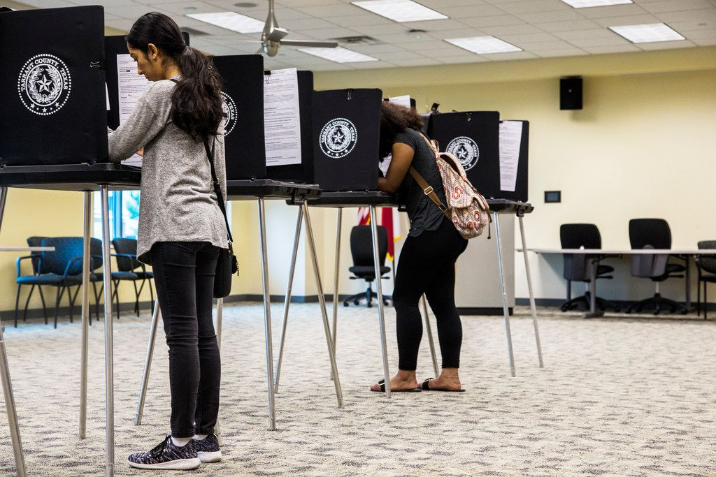 Zuleima Martinez, left, and Sananda McCall, both of Arlington, Texas cast their vote on Election Day at Tarrant County Sub-Courthouse in Arlington on Nov. 6, 2018. (Carly Geraci/The Dallas Morning News)