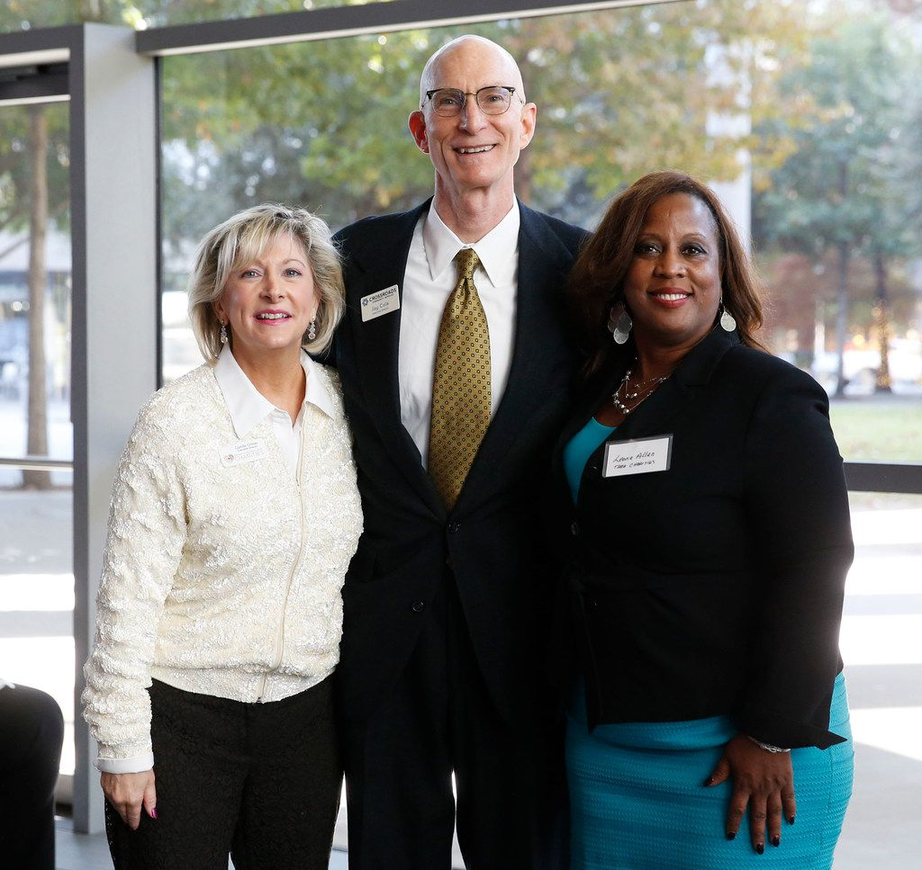 Camille Grimes (from left), the Rev. Jay Cole of Crossroads Community Services and Leona Allen, chair of the DMN Charities board, attended the kickoff Wednesday, where Cole received a distribution check for his agency.