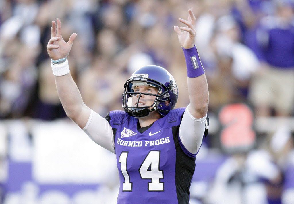 ORG XMIT: TXMF607 TCU quarterback Andy Dalton raises his arms after throwing a touchdown during the first half of an NCAA college football game against San Diego State in Fort Worth, Texas, on Saturday, Nov. 13, 2010. (AP Photo/Mike Fuentes)