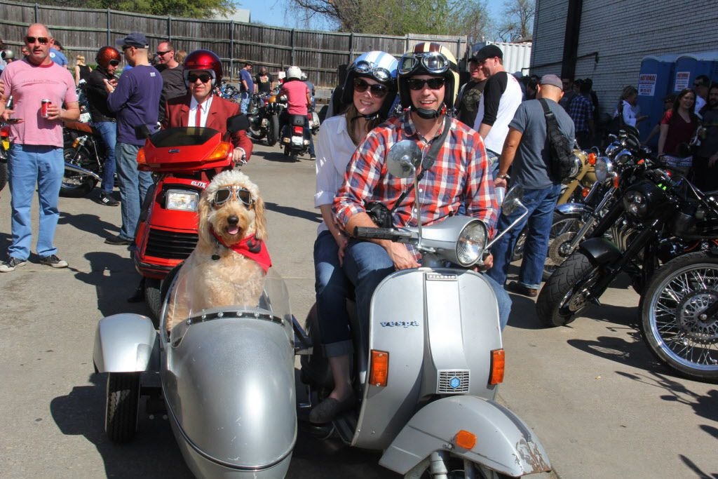James and Genesis Butler with their golden doodle Nelson at Rockers vs Mods motorcyle and scooter gathering at Sundown at Granada on March 28, 2015