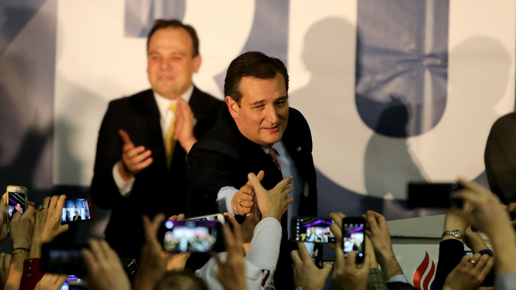 Sen. Ted Cruz reached out to supporters after winning the Iowa Republican caucuses on Monday. (Photo by Christopher Furlong/Getty Images)
