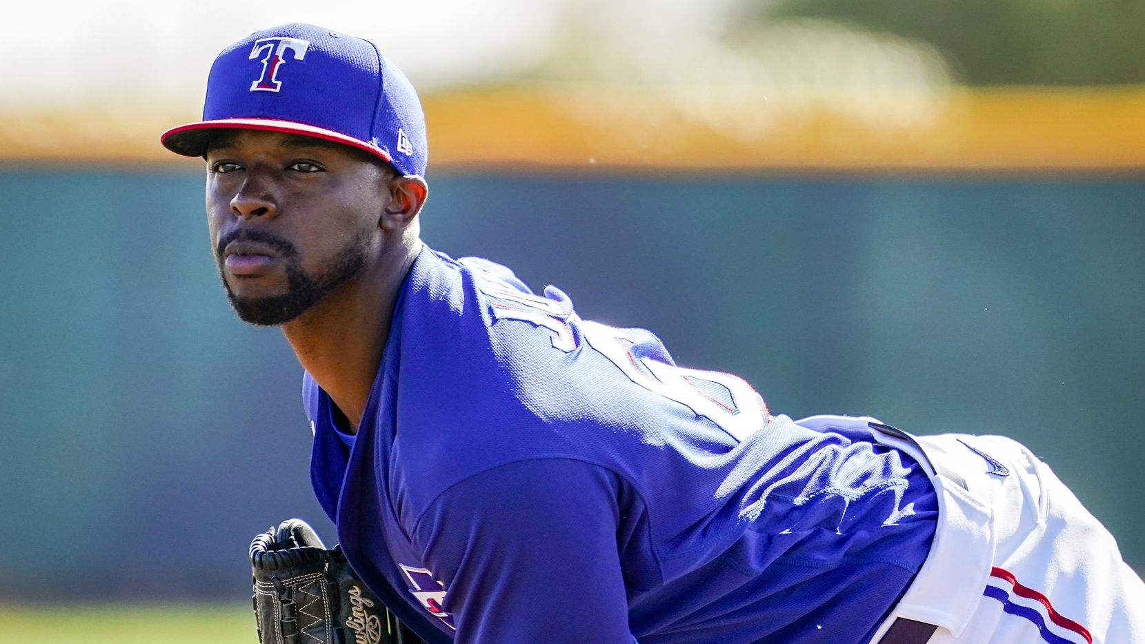 Texas Rangers pitcher James Jones participates in a fielding drill during a spring training workout at the team's training facility on Wednesday, Feb. 19, 2020, in Surprise, Ariz.