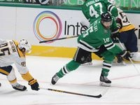 Dallas Stars center Joe Pavelski (16) attempts to get around the reach of Nashville Predators center Matt Duchene (95) during the first period of play in the Stars home opener at American Airlines Center on Friday, January 22, 2021.