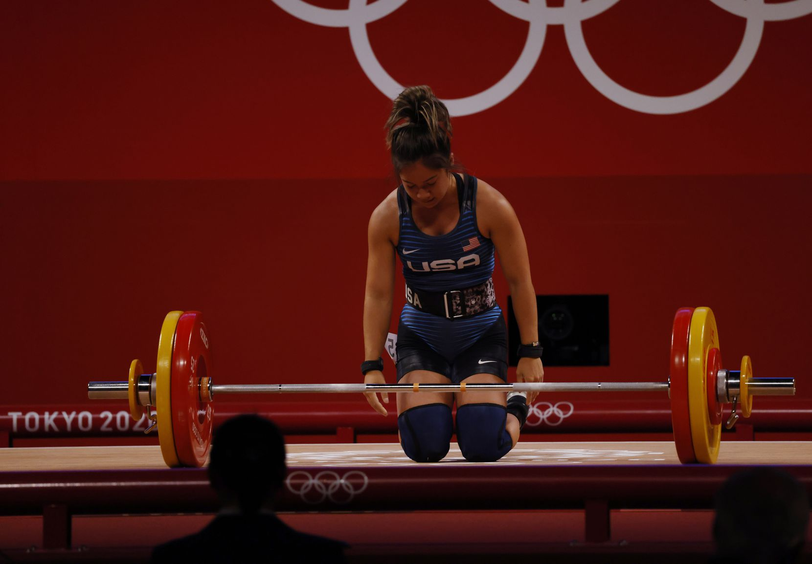 USA's Jourdan Delacruz dejected after an unsuccessful attempt in lifting 108 kg on her third attempt in the clean and jerk round during the women's 49 kg weightlifting final during the postponed 2020 Tokyo Olympics at Tokyo International Forum on Saturday, July 24, 2021, in Tokyo, Japan. Delacruz received a no-lift on all three attempts of the clean and jerk round. (Vernon Bryant/The Dallas Morning News)