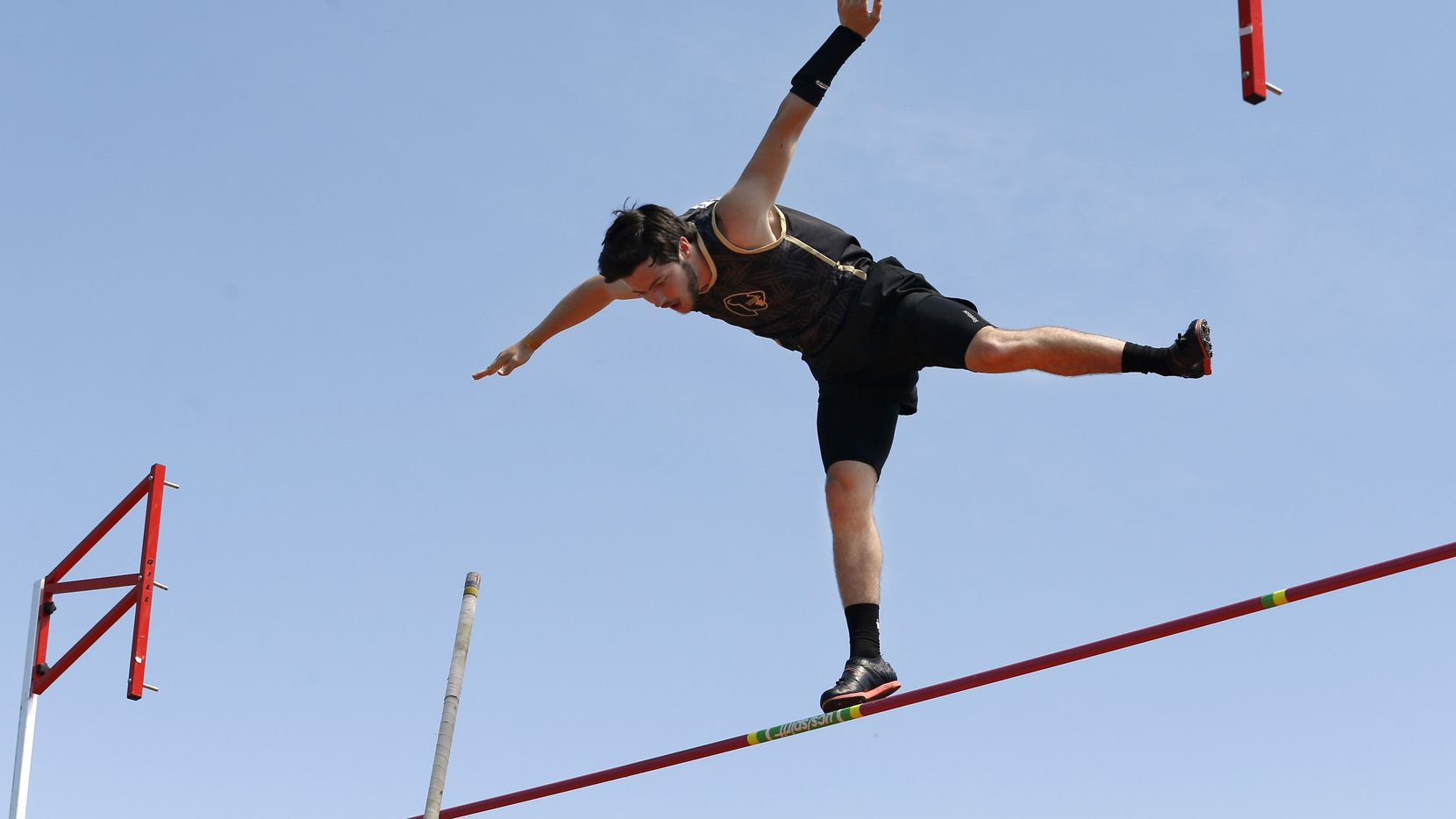 Pole vaulter Connor Gregston of Keller Fossil Ridge appears to be standing on the crossbar as he attempted a jump at 16 feet, 3 inches at the Class 6A Region I meet on April 26, 2019. Gregston finished second and qualified for the state meet. (Tom Fox/The Dallas Morning News)
