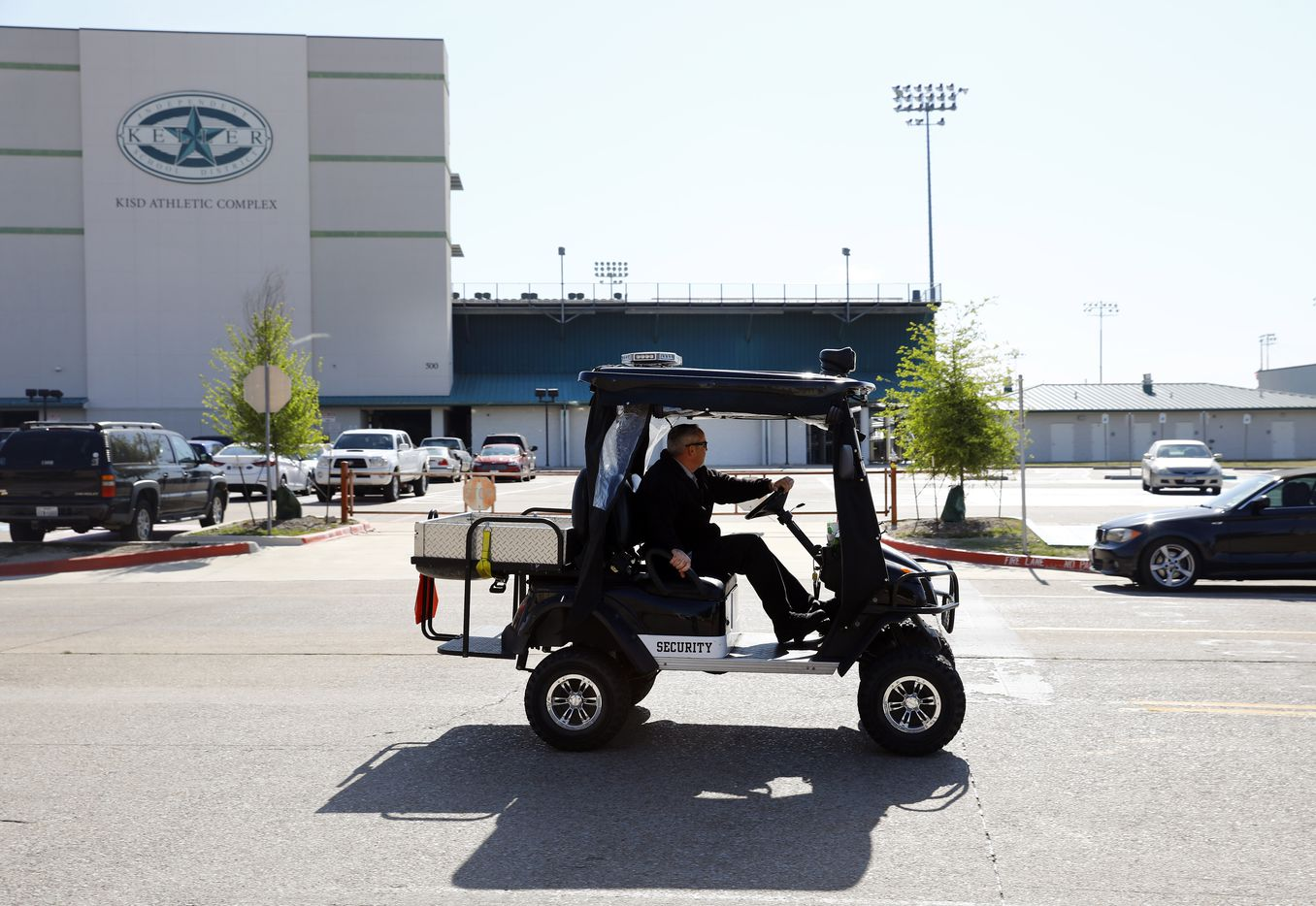 A Keller High School security patrolman passes by the Keller Athletic Complex after Keller ISD officials received information indicating an act of violence would take place at either a pep rally or a student-organized walkout.