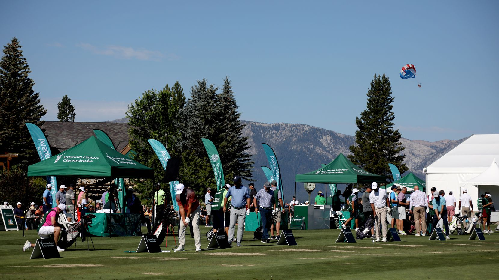 Golfers practice on the driving range during round one of the American Century Championship at Edgewood Tahoe South golf course on July 9, 2020 in South Lake Tahoe, Nevada.