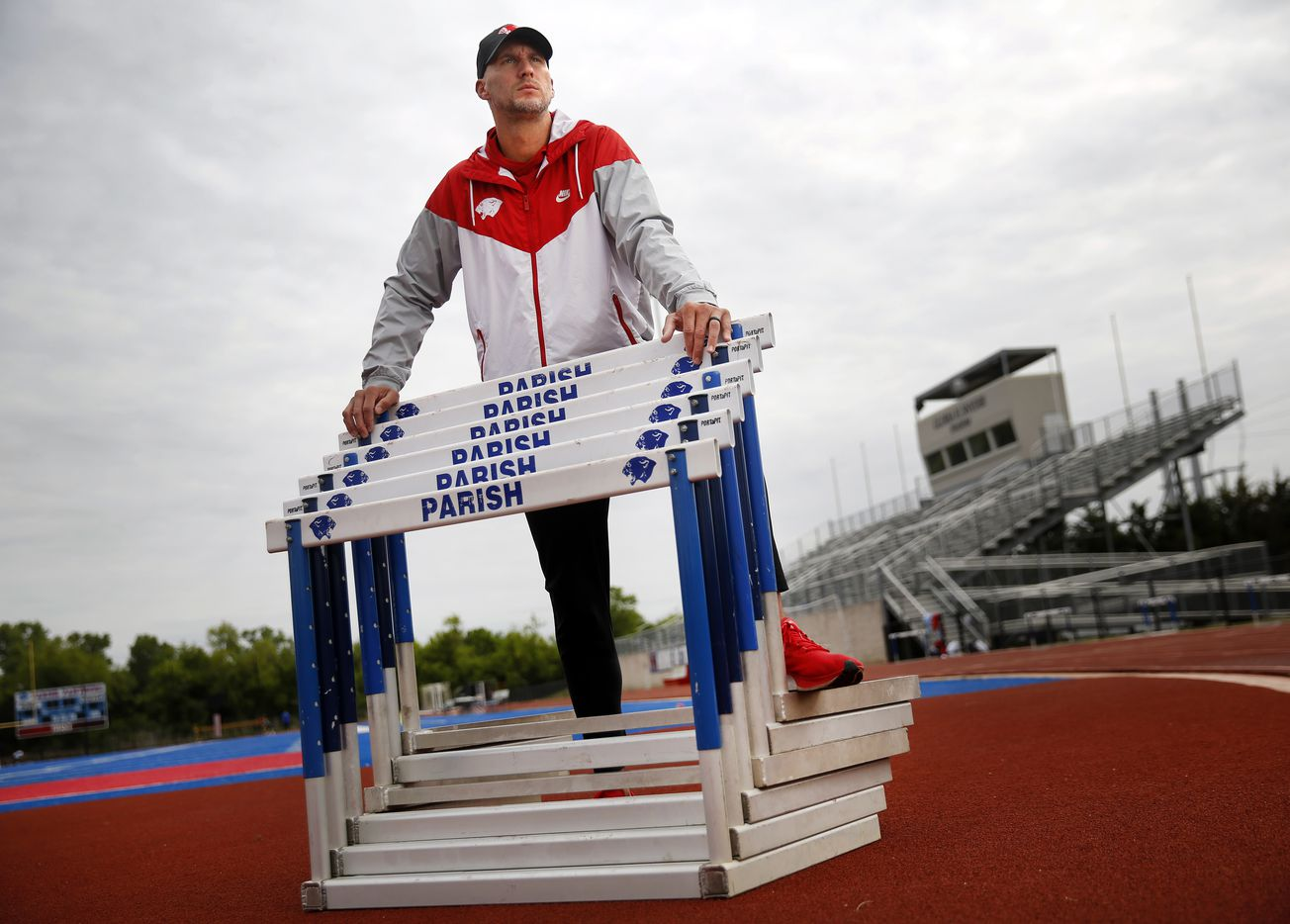 Parish Episcopal head track coach Jeremy Wariner poses for a photo at the schools stadium in Dallas, Wednesday, April 21, 2021.  The former Arlington Lamar and Baylor star who won three Olympic gold medals -- one in the 400 meters and two in the 4x400 relay, took over the program after retiring from competition. (Tom Fox/The Dallas Morning News)
