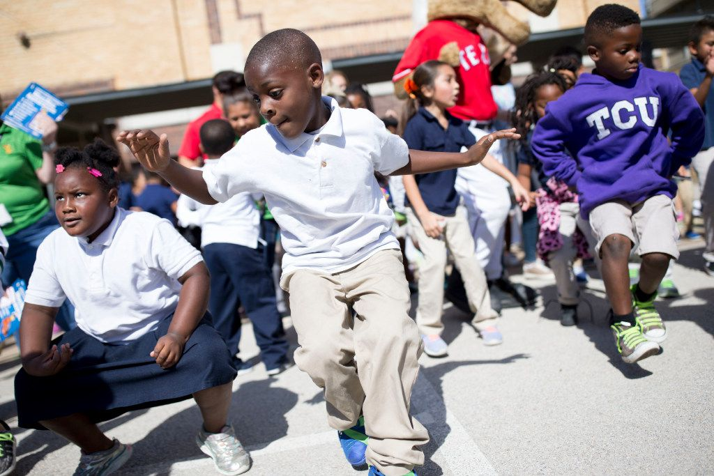 Deujerey Satchell (center), 7, showed off his dance moves during the kickoff of the training regimen for the Oncor Mayor's Race 5K at Ben Milam Elementary School in 2016.