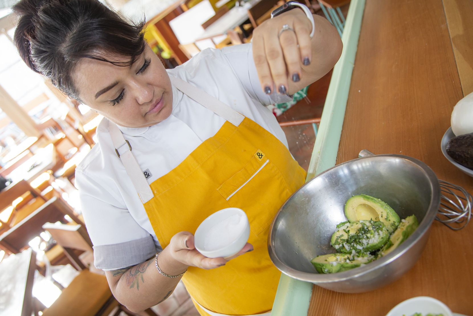 Chef Anastacia Quinones-Pittman adds salt as she prepares guacamole at Restaurant Jose, Wednesday, December 23, 2020.