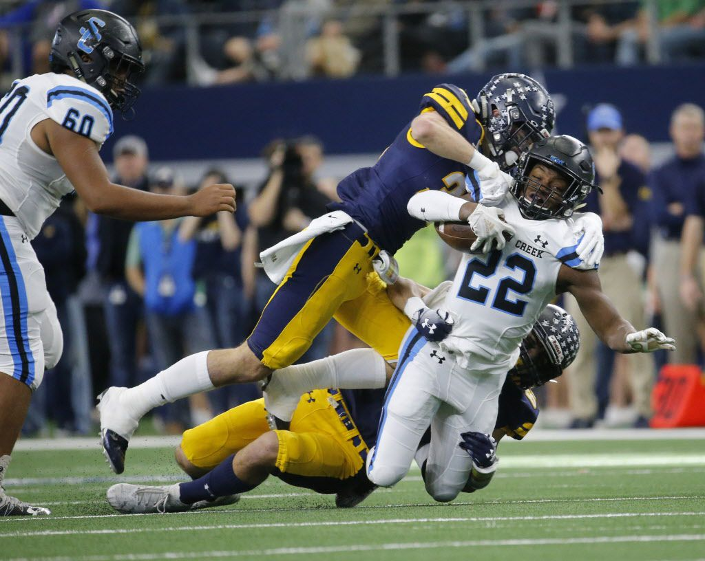 Highland Park's  Brock Bakich (35) and Saunders Wood (64) tackle Shadow Creek's running back Marquez Huland (22) during the first half of the Class 5A Division I football state championship game at AT&T Stadium in Arlington, Texas on Dec 22, 2018.  (Nathan Hunsinger/The Dallas Morning News)