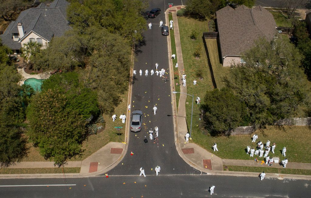 A bicycle remains in the middle of the street on Dawn Song Drive as investigators work at the scene of a bombing in the Travis Country neighborhood on Monday March 19, 2018, in Austin, Texas.