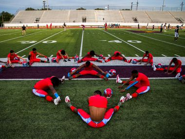 Carter football players stretch before a 4A high school football game between Carter and Crandall on Friday, September 20, 2019 at Sprague Stadium in Dallas.