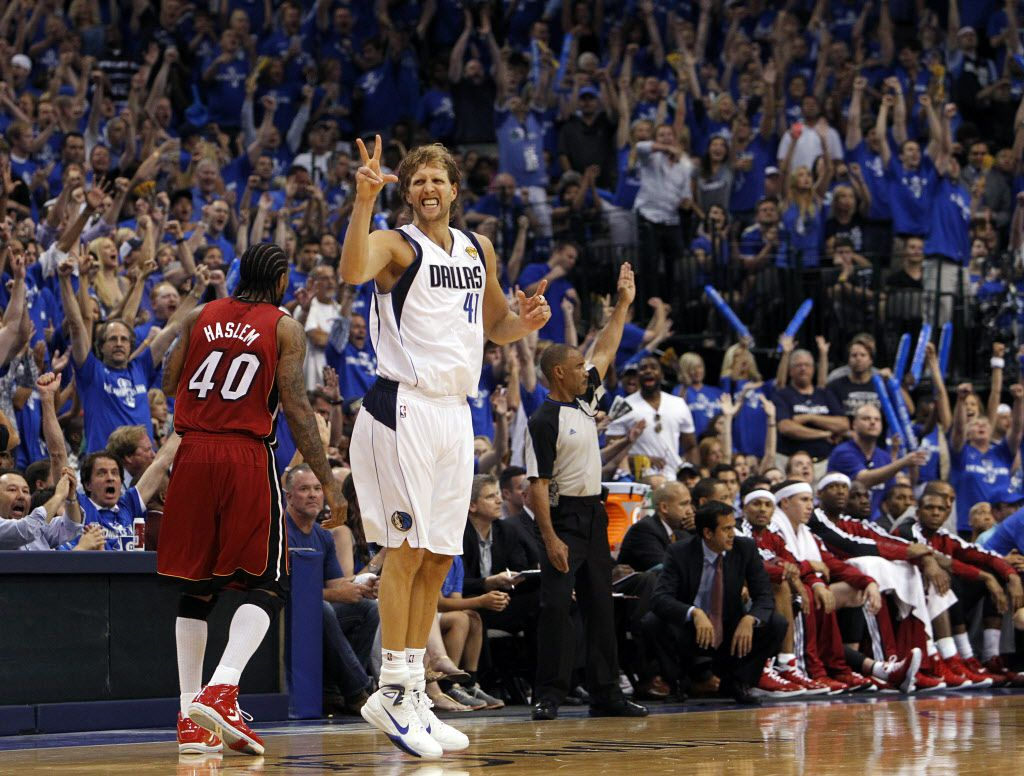 Dallas Mavericks power forward Dirk Nowitzki (41) holds up three fingers after nailing a three-pointer in the fourth quarter during Game 3 of the NBA Finals at American Airlines Center Sunday, June 5, 2011 in Dallas. Miami won 88-86 to take a 2-1 lead in the series.