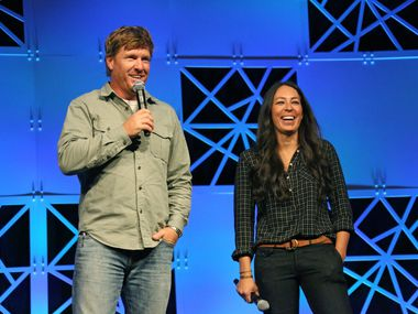 Chip and Joanna Gaines of Magnolia Homes and HGTV's Fixer Upper show are photographed while speaking at the Gaylord Texan Convention Center in Grapevine, Texas photographed on Wednesday, August 3, 2016. (Louis DeLuca/The Dallas Morning News)