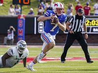 SMU quarterback Shane Buechele (7) scrambles away from Memphis defensive lineman O'Bryan Goodson (1) during the second half of an NCAA football game at Ford Stadium on Saturday, Oct. 3, 2020, in Dallas.