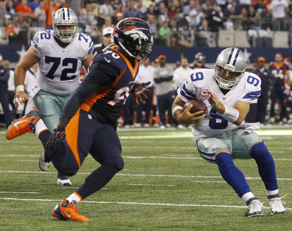 Dallas Cowboys quarterback Tony Romo (9) is stopped on a two-point conversion by Denver Broncos defensive end Shaun Phillips (90) during the second half of  their NFL football game in Arlington, Texas on October 6, 2013. Dallas lost 51-48. (Michael Ainsworth/The Dallas Morning News)