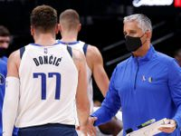 Dallas Mavericks assistant coach Igor Kokoskov (right) slaps hands with guard Luka Doncic (77) during a first half timeout against the Utah Jazz at the American Airlines Center in Dallas, Wednesday, October 6, 2021.