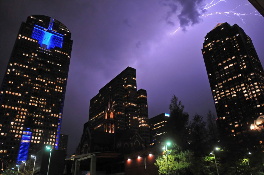 Lighting illuminates part of the downtown Dallas skyline over the Arts District in Dallas on Sept. 29, 2011.