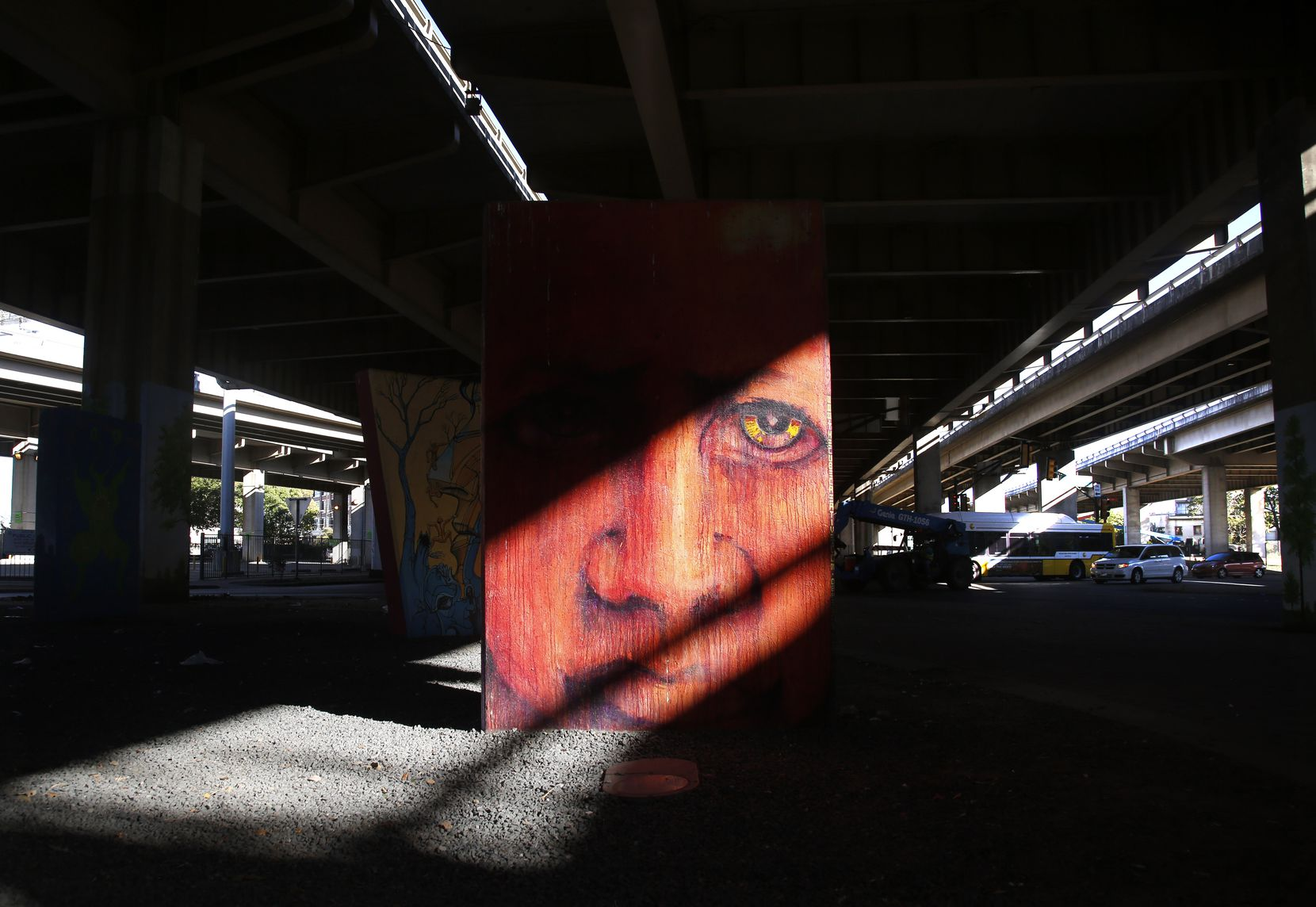 Afternoon sunlight pouring between spans of I-345 light up murals between Canton St. and Commerce St. in Deep Ellum in Dallas Tuesday, Oct. 17, 2017.