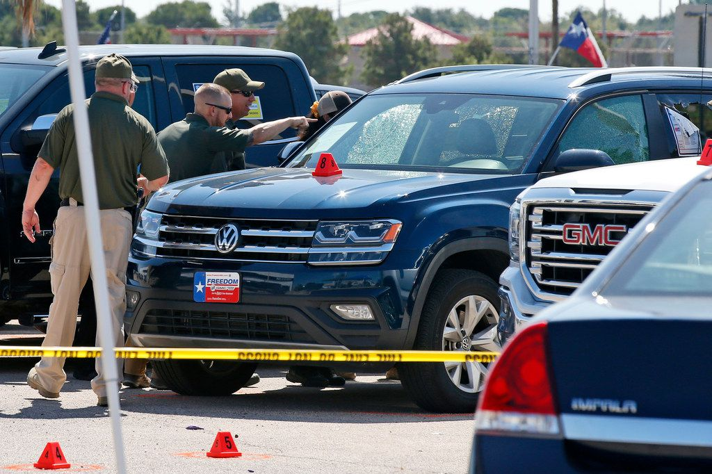 Officials continue to work the scene, Monday, Sept. 2, 2019, in Odessa, Texas, where teenager Leilah Hernandez was fatally shot at a car dealership during Saturday's shooting rampage.