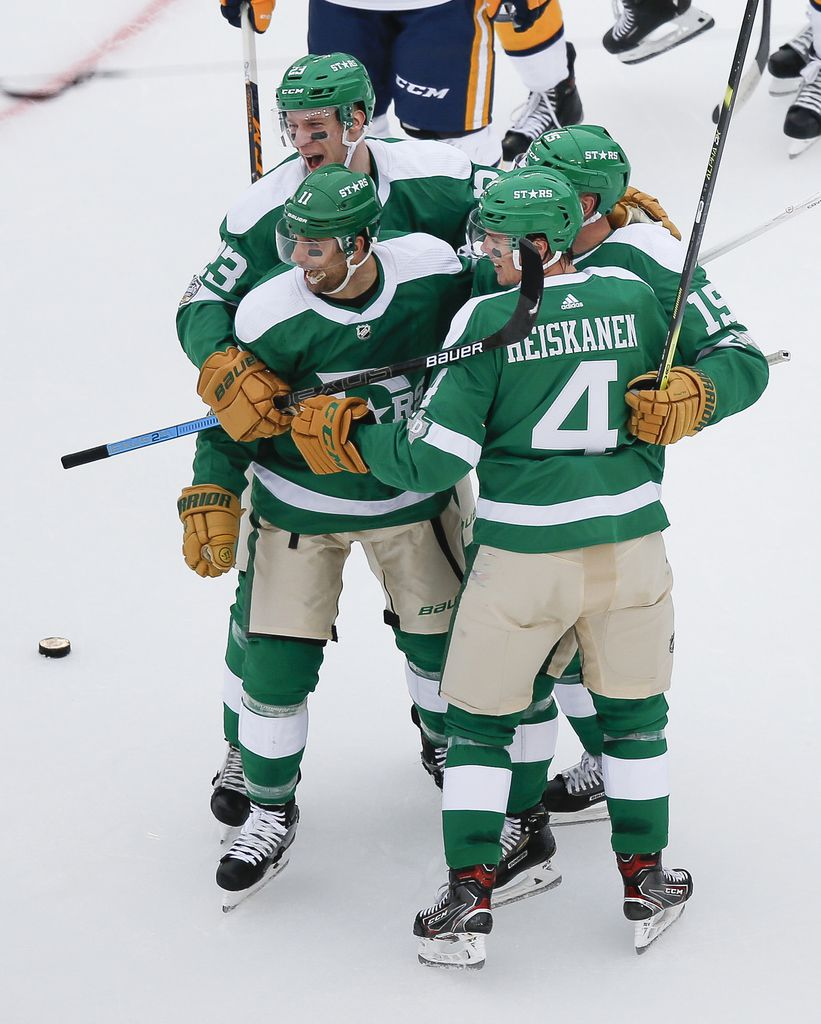 The Dallas Stars celebrate after a goal by Dallas Stars left wing Blake Comeau (15) during the second period of a NHL Winter Classic matchup between the Dallas Stars and the Nashville Predators on Wednesday, January 1, 2020 at Cotton Bowl Stadium in Dallas. (Ryan Michalesko/The Dallas Morning News)