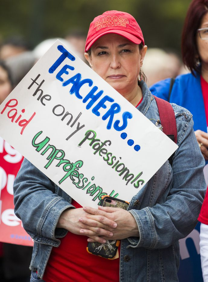 Alicia Requejo, a fourth grade teacher in Laredo, listens to a speaker during the Texas Public Education Rally on Monday, March 11, 2019 at the Texas capitol in Austin. Teachers pushed for school finance reform and pay raises.