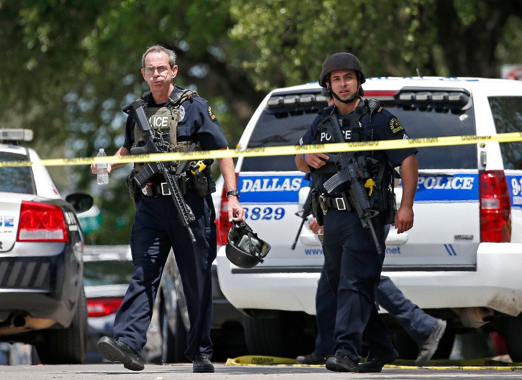 Dallas Police Department officers leave an office building in Lake Highlands near the High Five where police found two people dead inside the office building in Dallas, Monday, April 24, 2017. Crowe (Jae S. Lee/The Dallas Morning News)