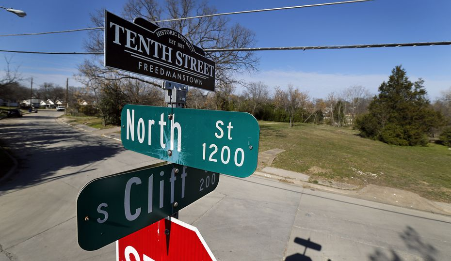 A street sign topper reminds residents of the historic Tenth Street Freedmanstown east of I-35E in the Oak Cliff area of Dallas.