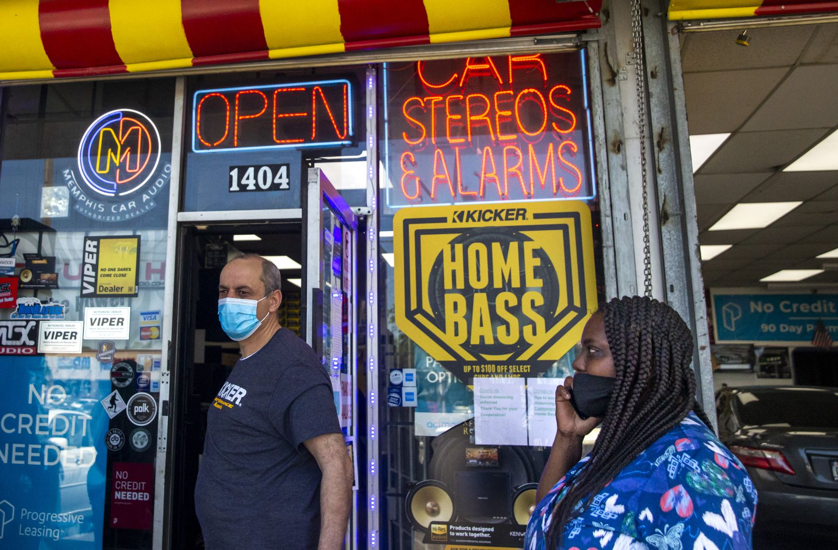 Owner Mike Shawar walks out of his business to tend to customers, including Tiffany Reed (right), at the Stereo Express on South Buckner Boulevard in South Dallas on Friday, May 1, 2020. The stereo store opened up again Friday morning after the state order against certain nonessential businesses operating during the COVID-19 pandemic was lifted.