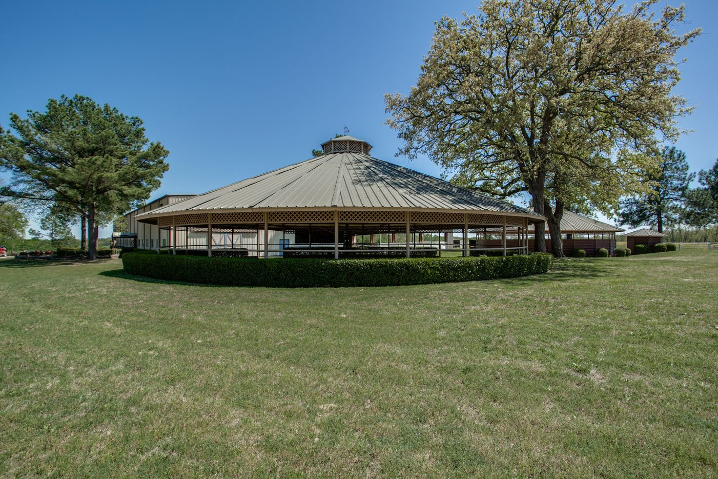 The property boasts a 32,000-square foot show barn and indoor arena.