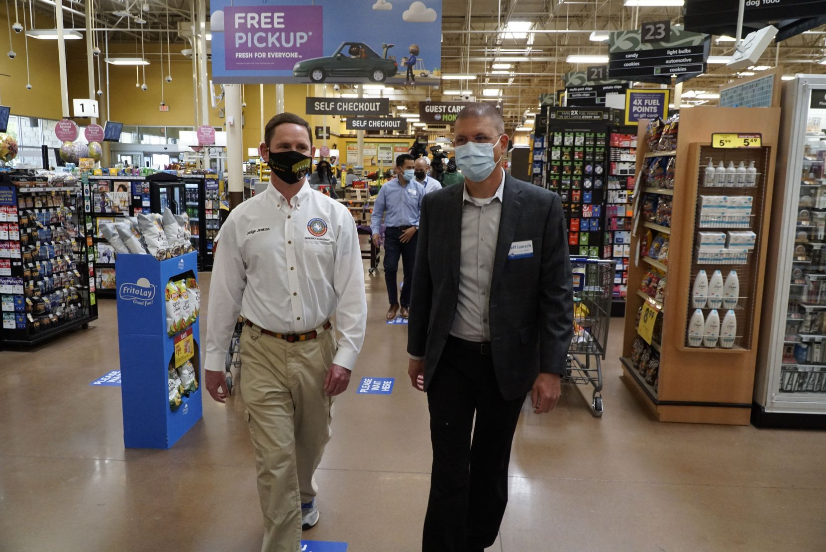 Clay Jenkins and Kroger Health Director (Dallas Division) Jeff Loesch at the Kroger store Maple Avenue in Dallas, Texas on Monday March 29, 2021. Kroger started a program that will allow their pharmacist to vaccinate store employees.