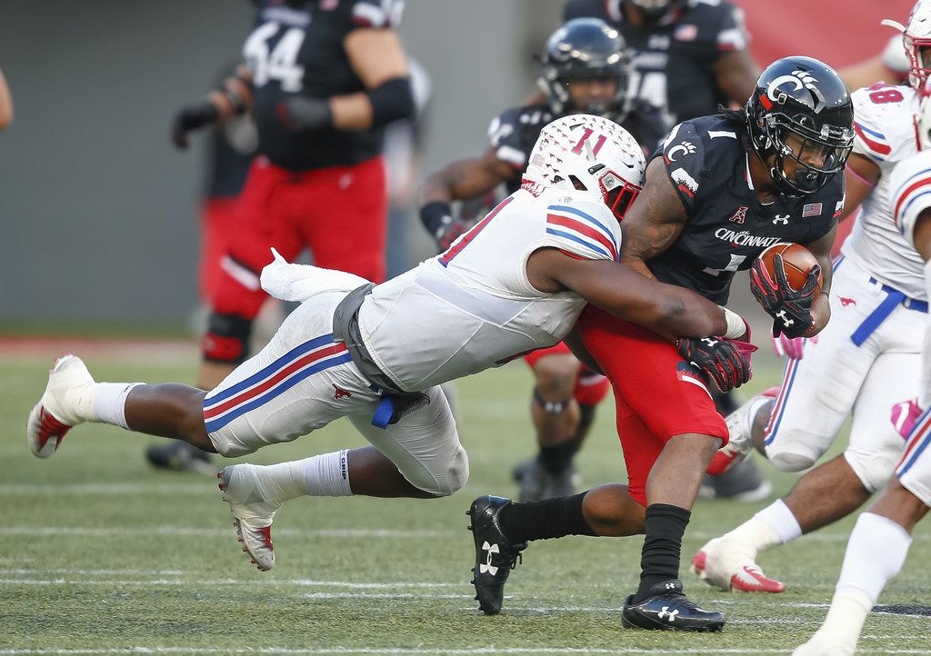 CINCINNATI, OH - OCTOBER 21: Kahlil Lewis #1 of the Cincinnati Bearcats runs the ball as Kyran Mitchell #11 of the Southern Methodist Mustangs makes the stop from behind at Nippert Stadium on October 21, 2017 in Cincinnati, Ohio. (Photo by Michael Hickey/Getty Images)