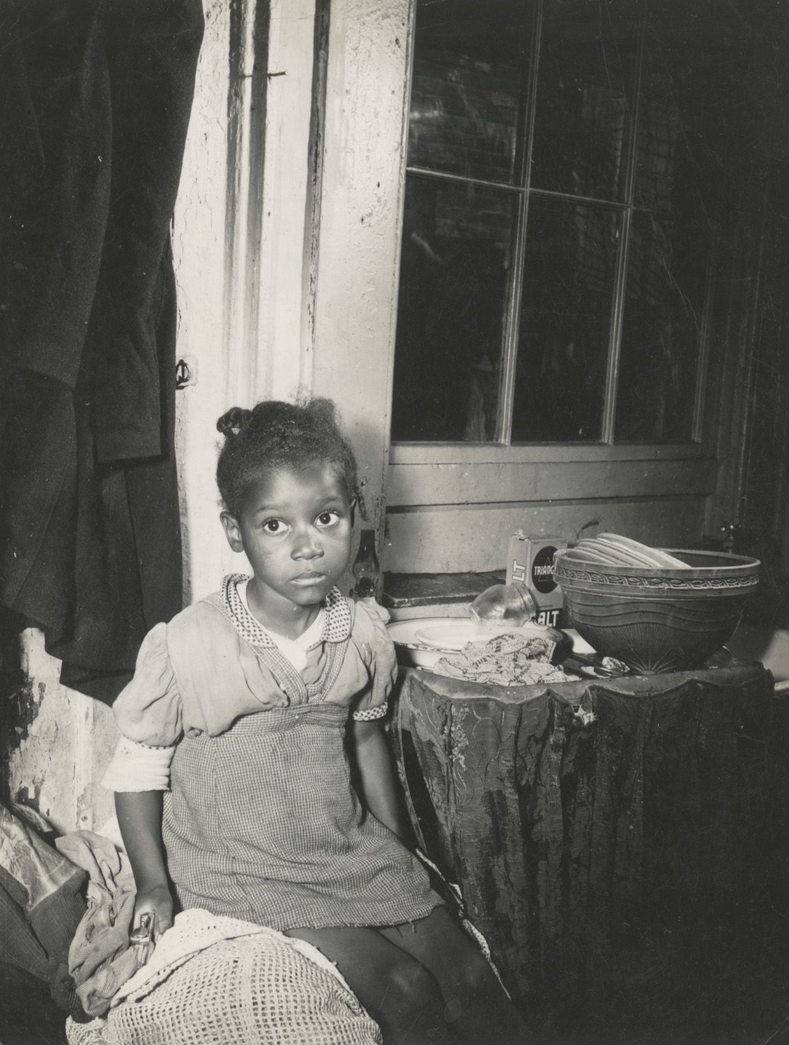 "Gordon Parks' portraits of children — such as this 1942 image of a girl who lived near Washington, D.C. — are perhaps the most haunting of all the images in ""The New Tide."""