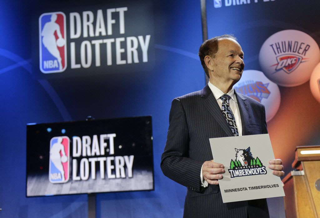 Minnesota Timberwolves owner Glen Miller poses for photos after the Timberwolves won the No. 1 pick in the NBA basketball draft lottery Tuesday, May 19, 2015, in New York.
