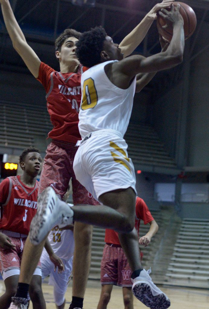 Woodrow Wilson's Beau Becker (in red) blocks a shot by South Oak Cliff's Rickey Campbell in the second half during the boys Class 5A bi-district playoff basketball game between South Oak Cliff and Woodrow Wilson, Tuesday, Feb. 25, 2020, in Dallas. (Matt Strasen/Special Contributor)