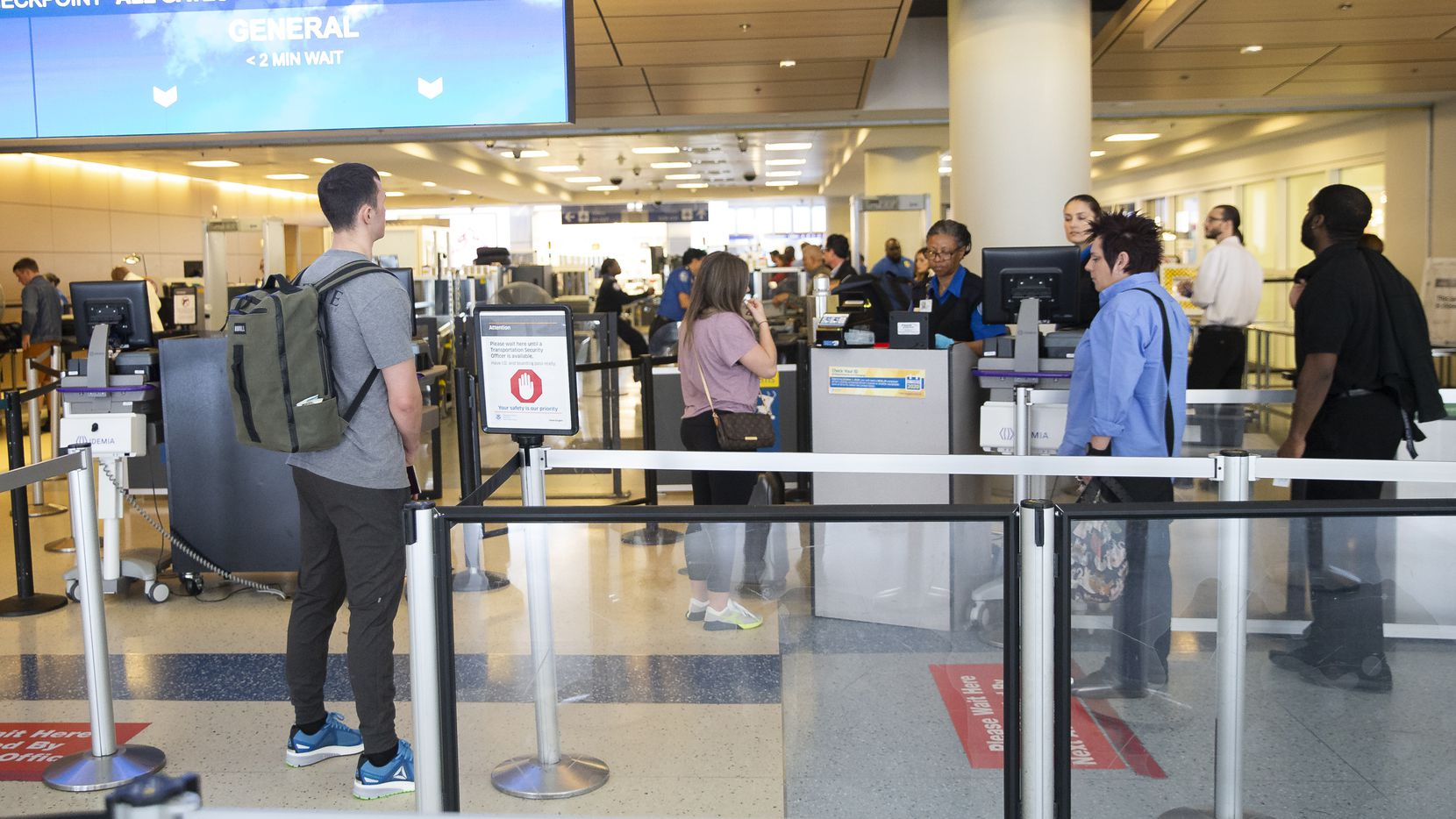 Travelers at DFW Airport wait to pass through TSA located at Terminal D on Feb. 17, 2020 in Grapevine. (Juan Figueroa/ The Dallas Morning News)