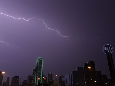 A bolt of lightning strikes over the downtown skyline in Dallas.