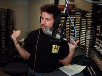 "Russ Martin pictured during his show on ""The Eagle"" KEGL-FM (97.1) in a 2003 file photo."