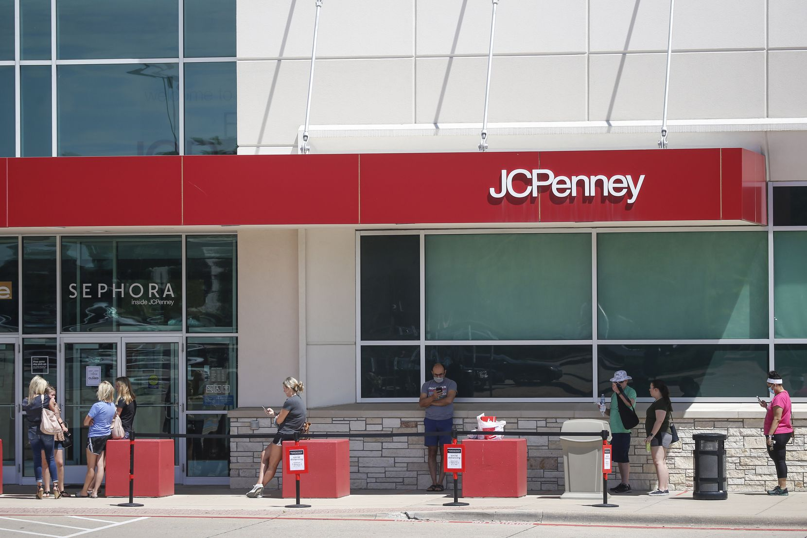 Shoppers lined up for the reopening of J.C. Penney on Friday in Fairview.