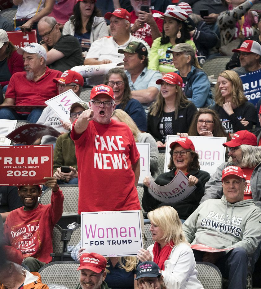 """A supporter shouts """"fake news"""" to toward the press pen before President Donald Trump arrived for a campaign rally on Thursday, Oct. 17, 2019, in Dallas."""