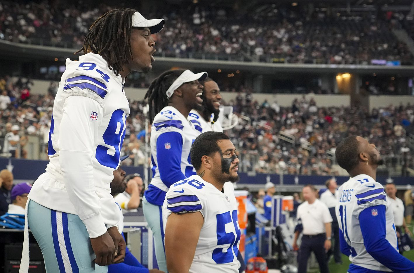 Dallas Cowboys defensive end Randy Gregory (94) cheers from the bench during the first half of a preseason NFL football game against the Jacksonville Jaguars at AT&T Stadium on Sunday, Aug. 29, 2021, in Arlington. (Smiley N. Pool/The Dallas Morning News)