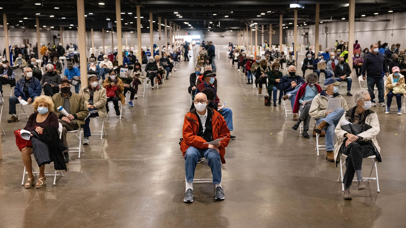 People wait to receive the COVID-19 vaccine at Fair Park in Dallas on Thursday, Jan. 14, 2021.