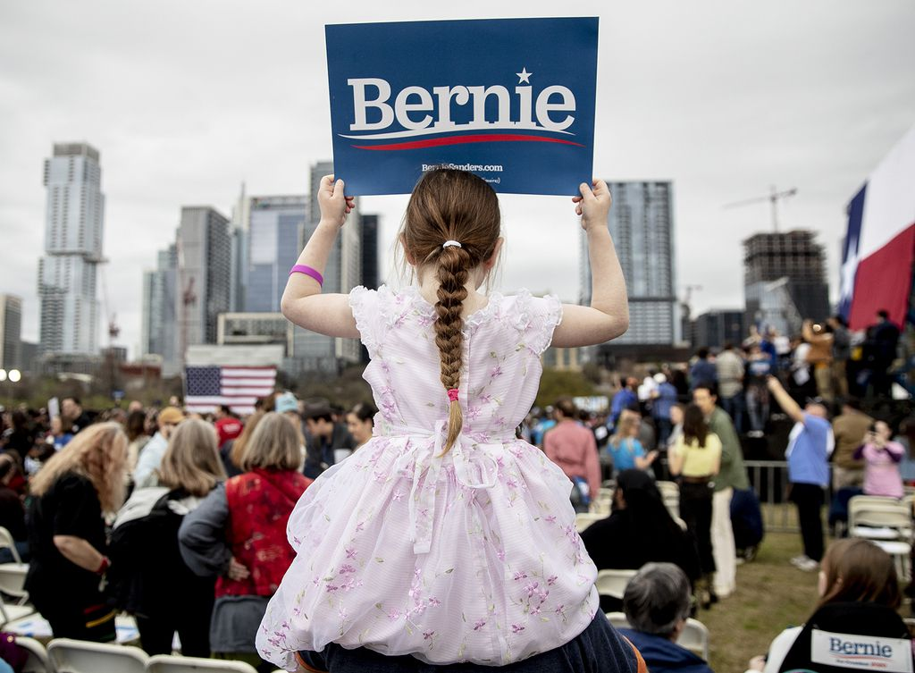 Lily Barbour, 5, holds up a campaign sign for Sen. Bernie Sanders, I-Vt., during a rally in Austin on Sunday, Feb. 23, 2020.