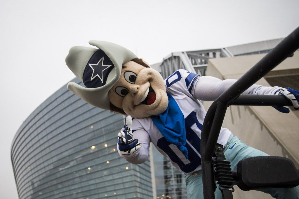 Rain doesn't dampen the spirits of Dallas Cowboys mascot Rowdy outside the stadium before an NFL football game between the Dallas Cowboys and the Carolina Panthers at AT&T Stadium on Thanksgiving Day, Thursday, Nov. 26, 2015, in Arlington.